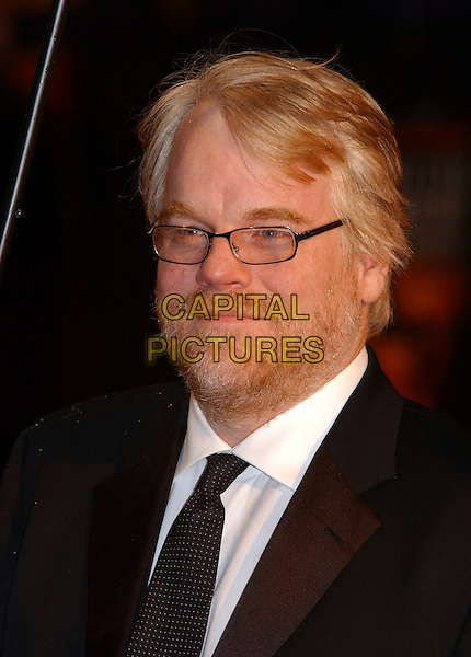 PHILLIP SEYMOUR HOFFMAN.Arrivals at The Orange British Academy Film Awards, .(BAFTA's) Odeon Leicester Square, London, England,.19 February 2006.bafta baftas portrait headshot glasses beard.Ref: FIN.www.capitalpictures.com.sales@capitalpictures.com.©Steve Finn/Capital Pictures.