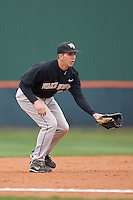 Third baseman Carlos Lopez #12 of the Wake Forest Demon Deacons on defense versus the Clemson Tigers at Doug Kingsmore stadium March 13, 2009 in Clemson, SC. (Photo by Brian Westerholt / Four Seam Images)