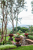 TANZANIA, a n outdoor garden in Gibbs Farm, overlooking coffee plantations