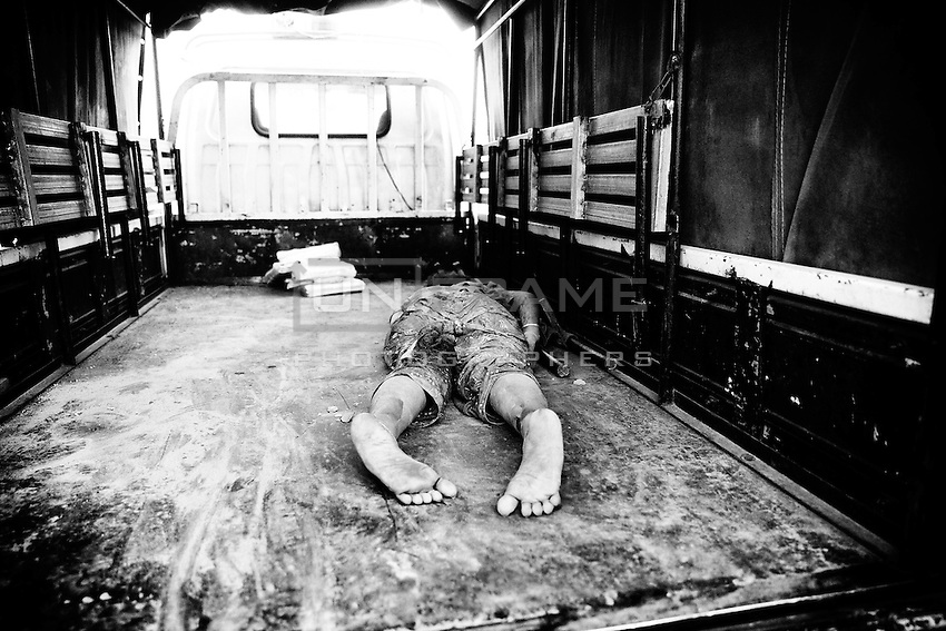 Dead body of a garments worker lay inside of the truck, Savar, near Dhaka, Bangladesh