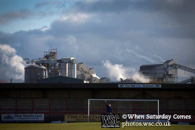 Witton Albion 1 Warrington Town 2, 26/12/2017. Wincham Park, Northern Premier League. A groundsman checks the height of the crossbar at Wincham Park, home of Witton Albion before their Northern Premier League premier division fixture with Warrington Town. Formed in 1887, the home team have played at their current ground since 1989 having relocated from the Central Ground in Northwich. With both team chasing play-off spots, the visitors emerged with a 2-1 victory, the winner being scored by Tony Gray in second half injury time, watched by a crowd of 503. Photo by Colin McPherson.