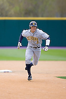 April 11, 2009:  University of California-Berkeley outfielder Brett Jackson steals third base during a Pac-10 game against the University of Washington at Husky Ballpark in Seattle, Washington.