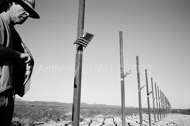 Naco, Arizona.USA.October 22, 2006..Gene Barbetta is a member of the of the Minuteman Civil Defense Corps of Arizona stands near the very high tech fence near the Arizona - Mexico border that the Minutemen are building for a rancher who lives in an area inundated with illegal immigrants passing through his land from Mexico after entering the country via the unfenced border a few feet away. The Minuteman Civil Defense Corps patrols this region to catch immigrants coming in illegally...