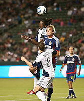 CARSON, CA – APRIL 30, 2011: New England Revolution midfielder Shairie Joseph (21) and Chivas USA forward Justin Braun (17) battle for the ball during the match between Chivas USA and New England Revolution at the Home Depot Center, April 30, 2011 in Carson, California. Final score Chivas USA 3, New England Revolution 0.