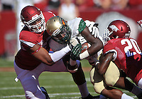 NWA Media/Michael Woods --10/25/2014-- w @NWAMICHAELW...University of Arkansas defenders Deatrich Wise Jr. (48) and De'Andre Coley (20) bring down UAB running back Jordan Howard in the 4th quarter of Saturday's game at Razorback Stadium in Fayetteville.