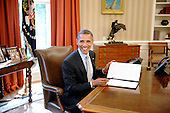 United States President Barack Obama signs a proclamation to designate federal lands within the former Fort Ord as a national monument under the Antiquities Act in the Oval Office of the White House in Washington, DC, April 20, 2012. Fort Ord is a former military base located on California's central coast and is a world-class destination for hikers, mountain bikers, and outdoor enthusiasts. .Credit: Olivier Douliery / Pool via CNP