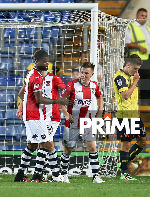 Matt Jay (right) of Exeter City celebrates his goal during the The Checkatrade Trophy match between Oxford United and Exeter City at the Kassam Stadium, Oxford, England on 30 August 2016. Photo by Andy Rowland / PRiME Media Images.