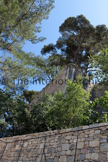 Built stone by stone, the restored walls of this medieval village house enclose a series of terraces and a bassin