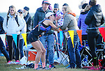 August 20, 2016 - Leadville, Colorado, U.S. -  Second place women's finisher, Maggie Walsh #802, gets a kiss from the youngest member of her support crew at the 24 mile Outward Bound aid station during the Blueprint for Athletes Leadville Trail 100, Leadville, Colorado.  Considered one of the most challenging endurance races in the world, ultra distance runners will navigate high altitude trails, challenging river crossings, and a variety of changing weather with an elevation gain of more than 18,000 feet ranging from 9200 feet near Twin Lakes to 12,600 feet atop the high point of Hope Pass.