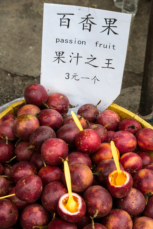 Yangshuo, China.  Passion Fruit for Sale by Sidewalk Vendor.