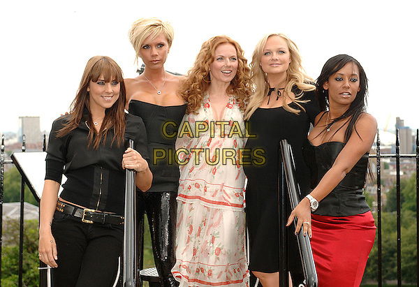 THE SPICE GIRLS - MELANIE CHISHOLM, VICTORIA BECKHAM, GERI HALLIWELL, EMMA BUNTON & MELANIE BROWN.The Spice Girls at a press conference in Greenwich to announce their world tour at the O2 Arena, London, England..June 28th, 2007.posh sporty ginger baby scary reunion half 3/4 length black strapless top mel c leather trousers cleavage blouse pink orange white dress floral print red skirt .CAP/BEL.©Belcher/Capital Pictures