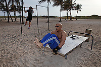 Mohsen Banafsheh works out along the beach in Lummus Park at sunrise. He is on vacation--from DC. <br /> The park  is on the Atlantic Ocean in the City of Miami Beach, and when redesigned and improved in the mid-1980s, it became the seed project for the redevelopment of what is now the Ocean Drive Deco District of SoBe (South Beach) from 5th to 15th Streets along Ocean Drive.