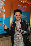 "One Life To Live's Jason Tam ""Markko"" stars in Broadway's musical Lysistrata Jones as ""Xander"" at the Walter Kerr Theatre, New York City, New York. Jason poses by the Lysistrata signage on December 17, 2011. (Photo by Sue Coflin/Max Photos)"