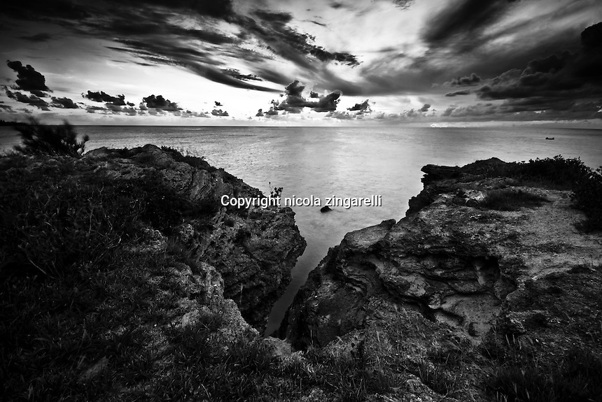 Cloudy sunset sky along the western coast of bermuda.