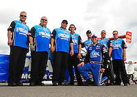 Mar. 9, 2012; Gainesville, FL, USA; NHRA top fuel dragster driver T.J. Zizzo and crew pose for a team portrait during qualifying for the Gatornationals at Auto Plus Raceway at Gainesville. Mandatory Credit: Mark J. Rebilas-