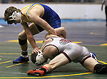 Paso Robles' Robby Standley and Lowry's Eric Brooks compete at the Sierra Nevada Classic wrestling tournament in Reno, Nev., on Friday, Dec. 28, 2012. .Photo by Cathleen Allison