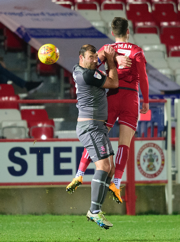 Lincoln City's Matt Rhead vies for possession with Accrington Stanley's Luke Charman<br /> <br /> Photographer Andrew Vaughan/CameraSport<br /> <br /> The EFL Checkatrade Trophy Second Round - Accrington Stanley v Lincoln City - Crown Ground - Accrington<br />  <br /> World Copyright © 2018 CameraSport. All rights reserved. 43 Linden Ave. Countesthorpe. Leicester. England. LE8 5PG - Tel: +44 (0) 116 277 4147 - admin@camerasport.com - www.camerasport.com