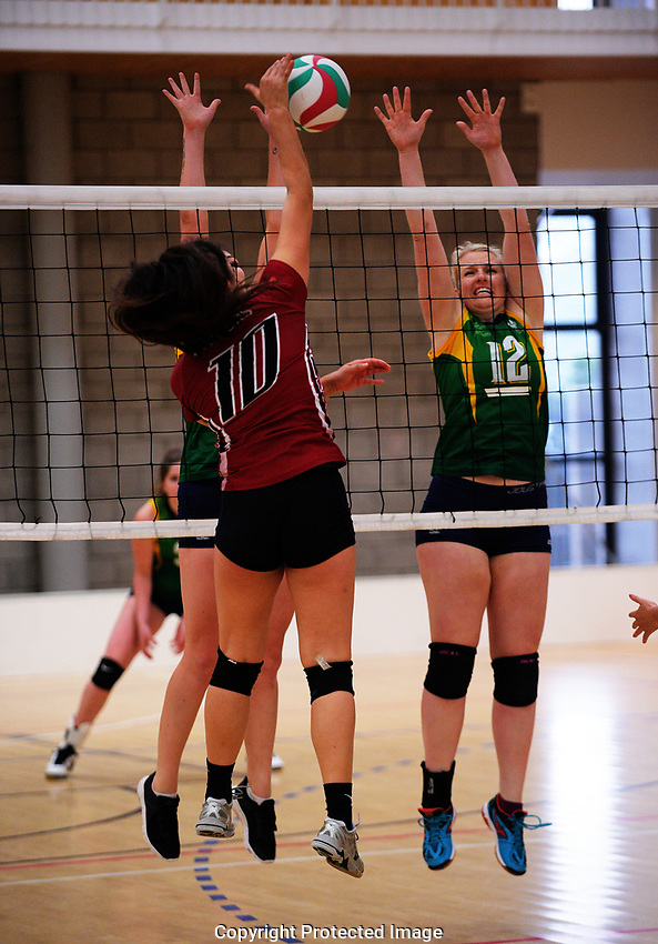 Action from the Volleyball NZ 50th National Club Championship women's division two match between Harbour Raiders B and Australian Defence Force at ASB Sports Centre in Wellington, New Zealand on Saturday, 12 October 2017. Photo: Dave Lintott / lintottphoto.co.nz