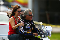 Sep 4, 2016; Clermont, IN, USA; NHRA funny car driver John Force (right) and wife Laurie Force during qualifying for the US Nationals at Lucas Oil Raceway. Mandatory Credit: Mark J. Rebilas-USA TODAY Sports