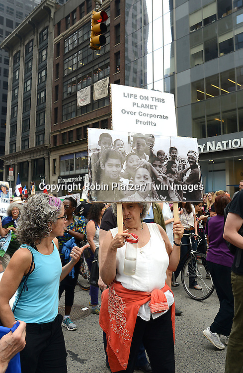 Marchers attend the People' Climate March on AVenue of the Americas on September 21,2014 in New York City. <br /> <br /> photo by Robin Platzer/Twin Images<br />  <br /> phone number 212-935-0770