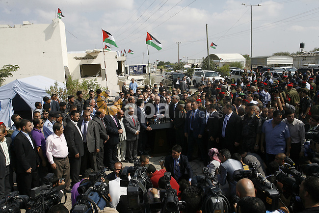 Palestinian Prime Minister Rami Hamdallah speaks to media upon his arrival to the Gaza Strip at Erez Crossing checkpoint, northern Gaza Strip on October 9, 2014. The Palestinian unity government which took the oath of office in June under technocrat prime minister Rami Hamdallah arrived to Gaza Strip on Thursday to convene the first fully meeting. Hamdallah said that the unity government will rebuild the bombed-out Gaza Strip following a seven-week Israeli offensive. Photo by Abed Rahim Khatib
