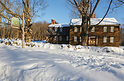 "Hartwell Tavern along the Battle Road at Minute Man National Historical Park in Lincoln, Massachusetts during the winter months. This is a restored 18th-century home and tavern. Originally built in 1732-1733, and restored by the National Park Service in the 1980s to its 18th-century appearance, this tavern was standing on April 19, 1775 (battles of Lexington and Concord, which marks the beginning of the American Revolutionary War). And because of this the National Park Service refers to this house as a ""witness house""."