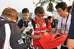 KUALA LUMPUR, MALAYSIA - MARCH 28: Ferrari driver Fernando Alonso of Spain sign autograph for fans ahead of the first practice session during the Malaysia Formula One Grand Prix at the Sepang Circuit on March 28, 2014 in Kuala Lumpur, Malaysia. (Photo by PETER LIM/PhotoDesk.com.my)