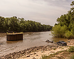 May 5, 2018. Fayetteville, North Carolina.<br /> <br /> People bring in a boat at the William O Huske Dam on the Cape Fear River. This is the dam closest to the Chemours plant.<br /> <br /> The Chemours Company, a spin off from DuPont, manufactures many chemicals at its plant in Fayetteville, NC. One of these, commonly referred to as GenX, is part of the process of teflon manufacturing. Chemours has been accused of dumping large quantities of GenX into the Cape Fear River and polluting the water supply of city's down river and allowing GenX to leak into local aquifers.