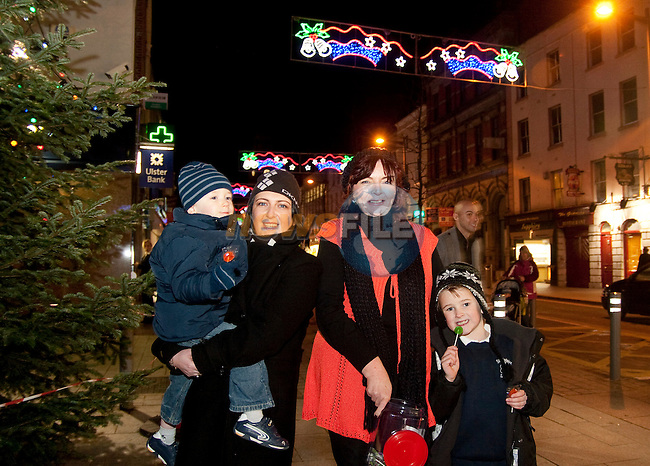 Patricia Rooney, President of Drogheda Chamber of Commerce, with Marian and Cormac Caddell and Joe McGouran at the switching on of the Christmas lights on West Street, last Friday.