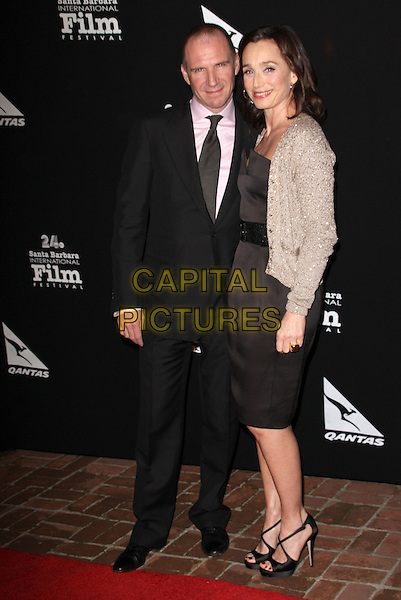 "RALPH FIENNES & KRISTIN SCOTT THOMAS .""Santa Barbara International Film Festival"" The Vanguard Award held at Lobero Theatre, Santa Barbara, California, USA..January 27th, 2009.full length black dress silver beige cardigan suit belt beads beaded .CAP/ADM/KB.©Kevan Brooks/AdMedia/Capital Pictures."