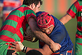 Louis Kapetine wrestles his way past Ben Thornton. Counties Manukau Premier Club Rugby game between Waiuku and Ardmore Marist, played at Waiuku on Saturday June 4th 2016. Ardmore Marist won 46 - 3 after leading 39 - 3 at Halftime. Photo by Richard Spranger.