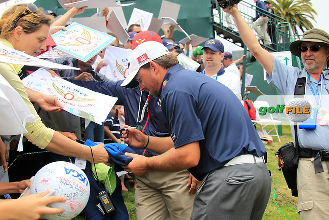 Graeme McDowell (NIR) signs autographs for the huge crowds after finishing his match on the 18th green during Tuesday's Practice Day of the 112th US Open Championship at The Olympic Club, San Francisco,  California, 12th June 2012 (Photo Eoin Clarke/www.golffile.ie)