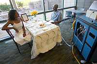 mayoheart 158497-- Charles Okeke has diner with his wife Natalie Okeke in a dining room at the Mayo Clinic Hospital. Once critically ill, he is now healthier due to the Total Artificial Heart, right. The Total Artificial Heart weighs 400 pounds keeping him stuck in the hospital until he can get a heart transplant or until he can be hooked up to a more portable version. (Pat Shannahan/ The Arizona Republic)