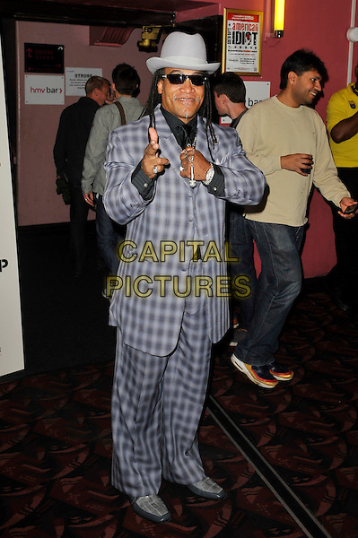 Melle Mel.'Something For Nothing: The Art of Rap'  European premiere arrivals, Hammersmith Apollo, London, England. 19th July 2012..full  length grey gray plaid checked suit hat sunglasses waistcoat microphone necklace hand .CAP/MAR.© Martin Harris/Capital Pictures.