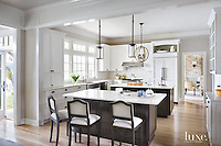 This contemporary kitchen features a sparkling Reina backsplash by Paul Schatz for New Ravenna.<br />