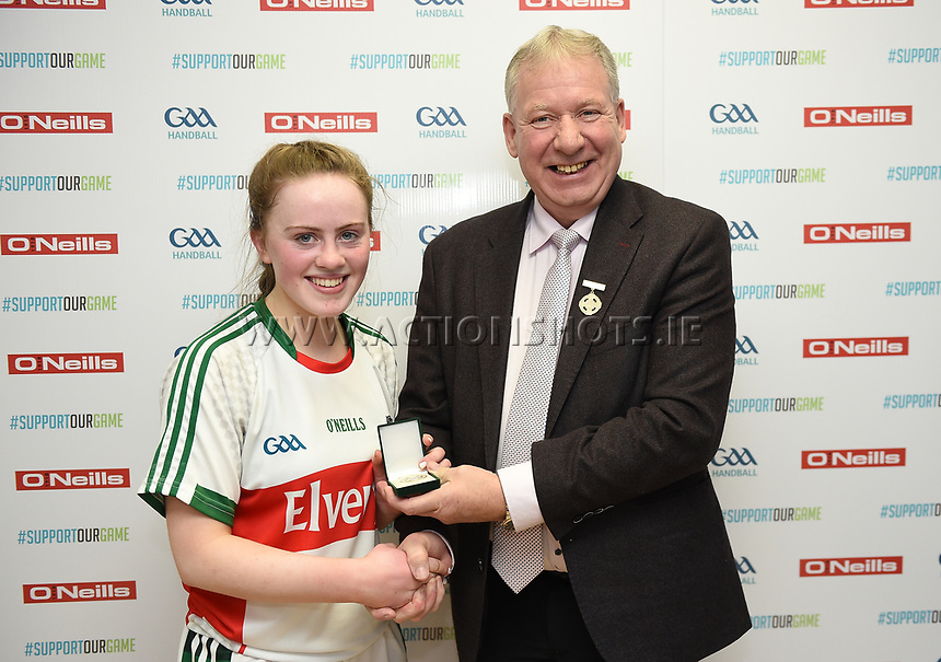 19/03/2018; 40x20 All Ireland Juvenile Championships Finals 2018; Kingscourt, Co Cavan;<br /> Girls Under-17 Singles; Mayo (Claire Reynolds) v Limerick (Aisling Shanahan)<br /> Claire Reynolds with GAA Handball President Joe Masterson<br /> Photo Credit: actionshots.ie/Tommy Grealy
