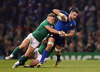 Damien Chouly of France is tackled by Ian Madigan of Ireland. Rugby World Cup Pool D match between France and Ireland on October 11, 2015 at the Millennium Stadium in Cardiff, Wales. Photo by: Patrick Khachfe / Onside Images