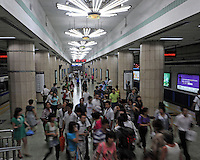 Passengers wait for the train on the platform of the Beijing Subway, China. Beijing Subway is a rapid transit rail network that serves the urban and suburban districts of Beijing municipality. It is the oldest and busiest subway in mainland China, and the second longest after the Shanghai Metro..30 Aug 2010