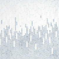 Perseid, a hand-cut tumbled mosaic, shown in Celeste and Thassos, is part of the Tissé® collection for New Ravenna.