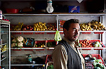 November 2012, Kabul , Afghanistan:  Former Woomera detainee Jumma Khan at his small fruit and veg shop in Kabul. He attempted to get to Australia but was sent back as an illegal immigrant.  Ethnic Hazara's, who have often made up vast numbers of refugees to Australia, having been persecuted and driven from their homes in both Afghanistan as well as from Quetta in Pakistan where a lot of displaced Hazara fled to during the Taliban years. Bamiyan is home to a lot of Hazara who are Shia muslim and as such are looked down upon by the Sunni Pashto tribes that make up the population majority in Afghanistan. Picture by Graham Crouch/The Australian Magazine.