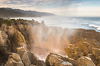 Sunrise in Punakaiki with limestone formation, pancake rocks in foreground, Paparoa National Park, Buller Region, West Coast, New Zealand, NZ
