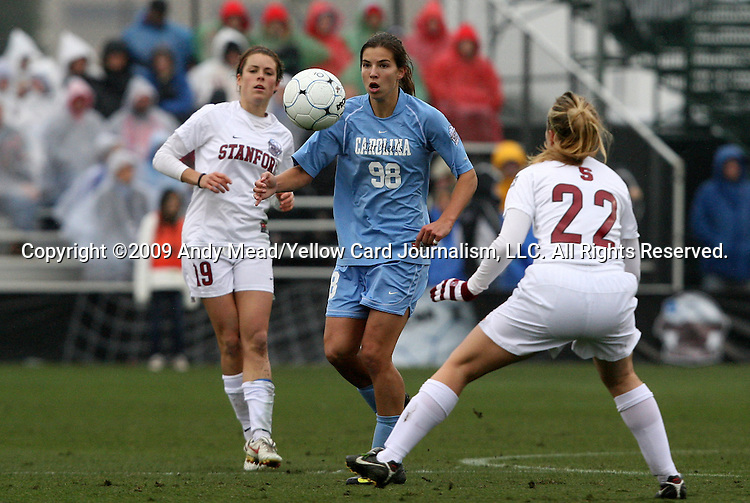 06 December 2009: North Carolina's Tobin Heath (98) plays the ball between Stanford's Kelley O'Hara (19) and Allison McCann (22). The University of North Carolina Tar Heels defeated the Stanford University Cardinal 1-0 at Aggie Soccer Stadium in College Station, Texas in the NCAA Division I Women's College Cup Championship game.