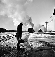 It's Been Good to Know Ya: Wolfsmith waves good-bye. Freight ops of the Chicago & Northwestern RR between Chicago and Clinton, Iowa. January 1943.<br /> <br /> Photo by Jack Delano.