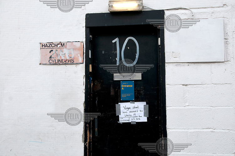 A sign on the door of number 10 Martello Street, a studio space in London Fields, Hackney, East London, announces that a photographic shoot for Vogue Magazine has been moved elsewhere.