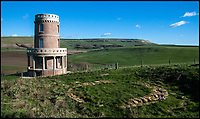 BNPS.co.uk (01202 558833)<br /> Pic: LandmarkTrust/BNPS<br /> <br /> Clavell Tower in it's spectacular location on the Jurassic Coast of Dorset.<br /> <br /> Revealed - Britain's most booked up room...and it's on a windswept clifftop on the Dorset coast.<br /> <br /> You might think the most popular getaway in Britain would be being pampered in a top London hotel or a swanky spa resort - but the Landmark Trust's Clavell Tower in Dorset is fully booked for the next two years - and hundreds of people are eagally awaiting the next release of dates to become avaiable.<br /> <br /> Holidaymakers who want to stay in a stunning clifftop tower that inspired literary greats Thomas Hardy and PD James will have a long wait - as it is fully booked until July 2019.<br /> <br /> The striking Clavell Tower overlooking Kimmeridge Bay in Dorset, is so popular the Landmark Trust, which runs the property, says as soon as six months of new dates are made available in the spring those will be booked up too.<br /> <br /> The Grade II listed 40ft tower, which was built in 1830, was saved from a watery grave by the Landmark Trust, a building conservation charity, more than a decade ago and opened to the public as a quirky holiday let in August 2008.<br /> <br /> Ever since then it has proved incredibly popular and currently has an 18-month waiting list - because that's as far ahead as the trust's booking calendar goes.