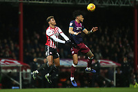 Aston Villa's Tyrone Mings out jumps Brentford's Ollie Watkins and heads the ball upfield during Brentford vs Aston Villa, Sky Bet EFL Championship Football at Griffin Park on 13th February 2019