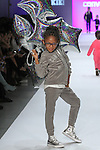 Model walks runway in an outfit from the Converse kids Fall 2017 collection, during the Rookie USA Fall 2017 kidswear fashion show, presented by Haddad Brands at NYFW: The Shows Fall 2017 at Skylight Clarkson Square on February 15, 2017.