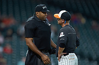 Home plate umpire Joe Harris explains a call to Sam Houston State Bearkats assistant coach Jay Sirianni during the game against the Mississippi State Bulldogs during game eight of the 2018 Shriners Hospitals for Children College Classic at Minute Maid Park on March 3, 2018 in Houston, Texas. The Bulldogs defeated the Bearkats 4-1.  (Brian Westerholt/Four Seam Images)