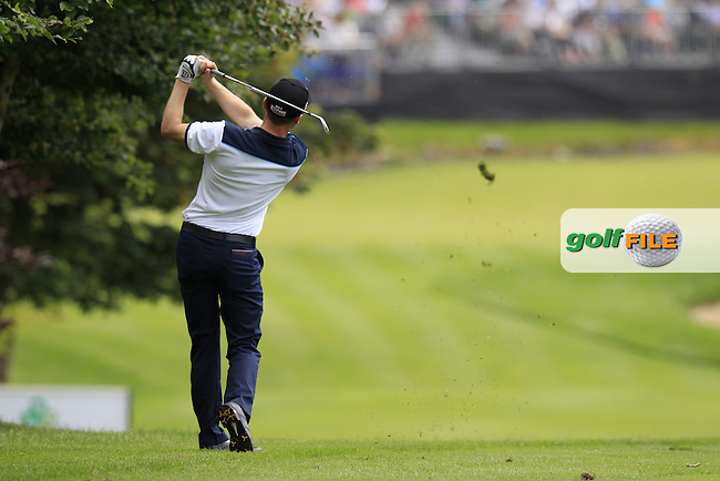 Michael Hoey (NIR) plays his 2nd shot on the 9th hole during Friday's Round 2 of the 2014 Irish Open held at Fota Island Resort, Cork, Ireland. 20th June 2014.<br /> Picture: Eoin Clarke www.golffile.ie