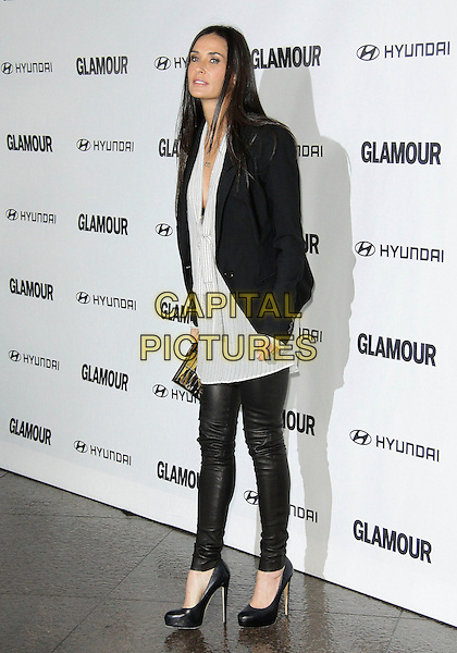 DEMI MOORE.The Glamour Reel Moments Presented by Hyundai held at The Directors Guild of America in West Hollywood, California, USA..October 25th 2010.full length grey gray white shirt pinstripe striped silver bra ow cut jacket blazer black gold clutch bag leather trousers pants shoes heels .CAP/ADM/TC.©T. Conrad/AdMedia/Capital Pictures.